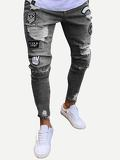 Men Patched Ripped Tapered Jeans
